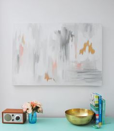 Make this DIY abstract artwork with a full tutorial and step-by-step pictures to help guide you. My secret weapon? Using gold foil paint for extra glam!