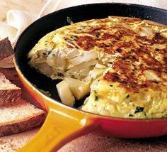 Spanish Omelette [or 'tortilla'. made with eggs, potatoes and parsley]