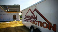Chapman Construction trailer on the job site for a new roofing project.