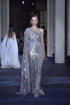 Zuhair Murad Look 50 Gorgeous Embellished Grey One Shoulder Sheath Evening Maxi Dress / Evening Gown with Long Sleeve and open Back. Couture Spring Summer 2019 by Zuhair Murad Haute Couture Dresses, Couture Fashion, Runway Fashion, Vestidos Fashion, Fashion Dresses, Beautiful Gowns, Beautiful Outfits, Glam Dresses, Evening Dresses For Weddings