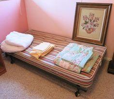 Found on EstateSales.NET: Twin bed frame, twin mattress, linens, Vintage Needlework picture