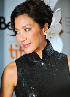 Michelle Yeoh in a sequined black Qipao