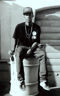 I like Hodgy's facial expression in this image as he looks like he is thinking and is also slightly funny. I also like the fact that he is just sitting in the image making it feel relaxed and natural. I think the fact he is sitting on a barrel is interesting because it makes the image very different and causes it too stand out.