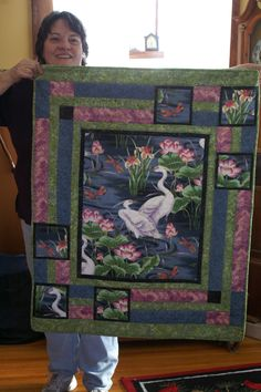 Panel quilt.  This is a oriental themed quilt for a friend.  There are a number of patterns out there to make good use of panels or a beautiful large print like this one.  Such fun.