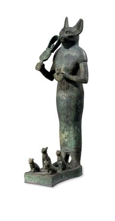 Bronze Figure of Bastet holding a sistrum  900 BC - 600 BC Late Period ~ Bastet transformed from a fierce wildcat of a war goddess to a domesticated cat goddess, that protected the Egyptian household.