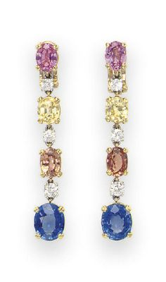 A PAIR OF MULTI-COLORED SAPPHIRE AND DIAMOND EAR PENDANTS, BY BULGARI  Each designed as a line of cushion and oval-cut blue, orange, yellow and pink sapphires, spaced by circular-cut diamonds, mounted in 18k gold and platinum