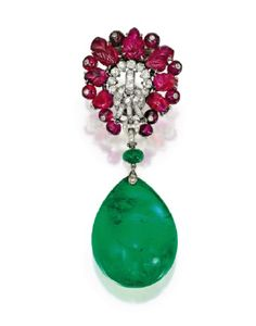 Carved Ruby and Diamond Clip-Brooch, by Cartier, London,with an Emerald Pendant. Mrs. C. Wrightsman