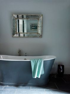 Secrets of French Decorating - add a free-standing porcelain tub - Cast-Iron Bathtub in French Bathroom French Decor, French Country Decorating, Parisian Decor, Parisian Apartment, Deep Tub, French Bathroom, Cast Iron Bathtub, French Style Homes, Modern Vanity