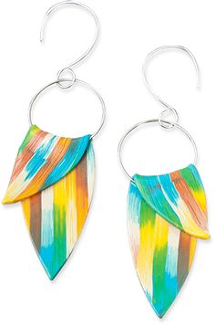 A slice of polymer cane artfully draped over a swinging silver loop makes a particularly breezy summer earring. The pointed elliptical shape reminds us of blooming petals. Anna Kokareva