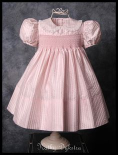 https://flic.kr/p/99cZbk | Smocked silk seersucker yoke dress | This yoke dress is made of silk seersucker.  The collar and sash are silk organza trimmed with a French val lace.  Seed beads are incorporated into the smocking.