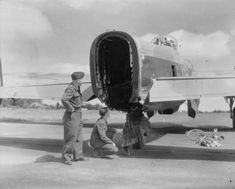 Back at their base, East Wretham, Norfolk, two members of the crew of Avro Lancaster B Mark II, DS669 'KO-L', of No. 115 Squadron RAF, examine the rear of their aircraft, where the rear turret, with its unfortunate gunner, was sheared off by bombs dropped from an aircraft flying above, during a raid on Cologne on the night of 28/29 June 1943.