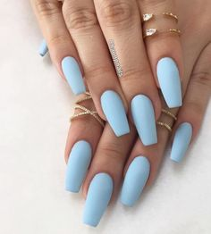 Nail art is a very popular trend these days and every woman you meet seems to have beautiful nails. It used to be that women would just go get a manicure or pedicure to get their nails trimmed and shaped with just a few coats of plain nail polish. Blue Acrylic Nails, Acrylic Nail Designs, Blue Matte Nails, Pastel Blue Nails, Acrylic Summer Nails Coffin, Matte Nail Polish, Nail Nail, Nail Glue, Acrylic Nails Almond Classy