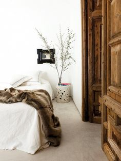 Neutral bedroom with faux fur throw