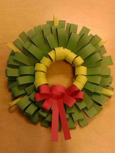 Construction paper  Christmas wreath.
