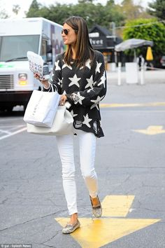 Stylish star: The Brazilian beauty was seen making her way to her car in a starry jumper w...