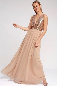 The Elegant Encounter Champagne Sequin Maxi Dress was made for fairy tale endings! A sleeveless sequin bodice with no-slip strips, and plunging V-neckline, is met by a fitted waist, and full woven maxi skirt, in a nude hue. Hidden back zipper/clasp.