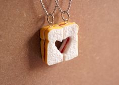 Because both of you are unique like peanut butter and jelly but when they combine, it turns perfect; Show your bestie/loved one how much you treasure your friendship/relationship with this set of PB+J Sandwich necklace set!  I sculpted the set of sandwiches by hand from polymer clay, giving the bread texture and toasty-outside. I then cut out a heart shape, mixed in just the right colour for the peanut butter and jelly and added them to finish off this set of delicious and cute set!...
