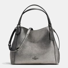 Coach, $295. Soft and slouchy in metallic pebble leather, our new, slightly smaller Edie has a perfect purity of design that belies the superb three-compartment organization hidden within. This easy, lightweight bag comes finished with a mini turnlock and dimensional bombé strap anchors inspired by Bonnie Cashin's original designs from the brand archive.