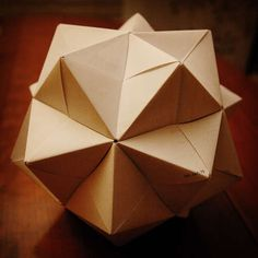 Modular origami << stellated octahedron, a stellated icosahedron , or a simple cube. (Poor photos, poor instructions)