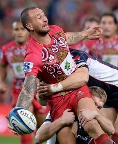 Quade Cooper of the Reds offloads during the round 16 Super Rugby match between the Reds and the Rebels at Suncorp Stadium on June 1, 2013 in Brisbane, Australia.
