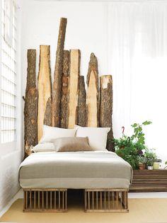 Love the headboard made of cut tree trunks @istandarddesign