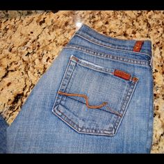 """7 For All mankind 7FAMK Flare Leg 32"""" inseam jeans 7 For All mankind 7FAMK Flare Leg Signature Squiggle Minimal wear on bottoms of legs, excellent condition otherwise Approx. 32"""" inseam Size 27. Item Location Bin 1 7 for all Mankind Jeans Flare & Wide Leg"""