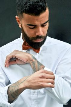 Tats & bow tie.  via Trapped In My Mind
