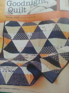 From Fon's & Porter Summer 2016 Triangle Quilts - Goodnight, Quilt by Nicole Maroon - Love this!  I've been hording this fabric for awhile.  Maybe I'll finally use it!