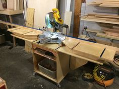 Miter stand with positionable fences and saw. The fences come off and wings fold down for transport.