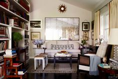 Claudia Benvenuto bungalow sitting area, sunburst, flea market finds, mirror block print bolster, bookcases, caned arm chair
