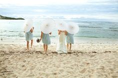 Destination Weddings: Simple yet romantic hurricane with candles, sand and shells (Photo by: Mindy Bean Photography)