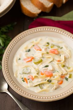 A hearty and comforting creamy chicken noodle soup that'll keep you cozy all night long. This soup is so easy to put together and is always a big hit with the family. Easy comfort food for any day of the week! Soup Recipes, Chicken Recipes, Cooking Recipes, Bread Recipes, Crockpot Recipes, Vegan Recipes, Chicken Noodle Soup, Chicken Tortellini, Chicken Soups