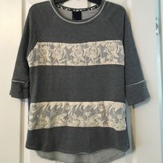 Anthropologie Shirt Knit shirt with 3/4 sleeves. Feminine lace detail across chest. Size small. Excellent condition, worn only once! Anthropologie Tops