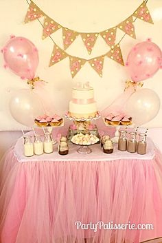 Pink + gold party with tulle pom balloons and tulle skirted table: menu included milk in vintage glass jars, chocolate cupcakes, layered pudding jars and meringue cookies