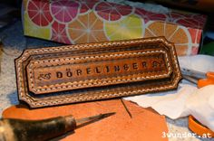 And now for something completely different: Türschild aus Leder (ein Weihnachtsgeschenk) / hand tooled leather name plate (a Christmas present)