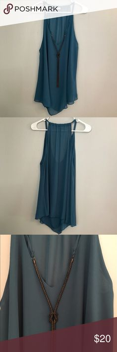 Blue boutique tank top Worn twice!! Bought at a boutique where I go to school. Size large, long and flowy. Sheer fabric so the back is a little see through, but the front has 2 layers so it is not see through. The chain on the front is connected. I've layered this over a tight black tank top dress to wear as a dress! Tops Tank Tops