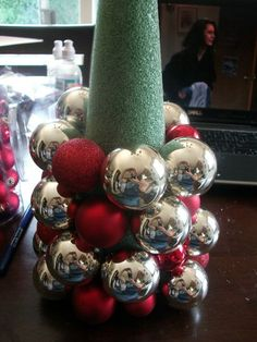 Ornament Tree - For a quick Christmas decoration, hot glue your old plastic ornaments to a Styrofoam cone.