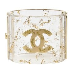 Pre-owned Chanel Clear & Metallic Gold Resin Glittered 'CC' Cuff... ($1,300) ❤ liked on Polyvore featuring jewelry, bracelets, chanel, glitter jewelry, chanel jewelry, chanel jewellery, clear cuff bracelet and resin jewelry