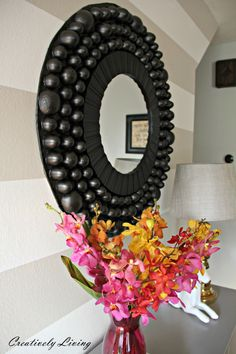 Can you guess what this stunning DIY Bubble Mirror is made out of? Wouldn't it be beautiful in my entryway?