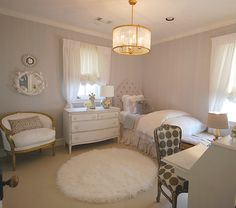 I don't usually like neutral rooms, but this is pretty.  Love the chandelier & layout