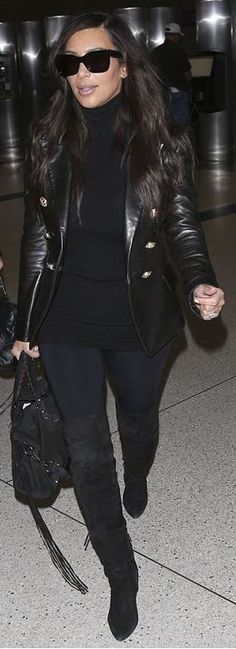 Who made Kim Kardashian's black leather jacket, suede handbag, and sunglasses?