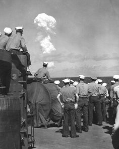 """US Navy sailors watch the cloud plume after a nuclear detonation code named 'Able' Bikini Atoll in the Marshall Islands July 1 1946 The nuclear detonation was the first of """" Operation Crossroads""""."""
