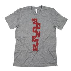 ACTUAL TEXT 'SCONSIN OUR COMMENTARY This shirt contains a distressed look as part of the original design. Noisey... on purpose! FABRIC DETAILS MENS: Tri-Blend Tee / 50% Poly, 25% Cotton, 25% Rayon WOM