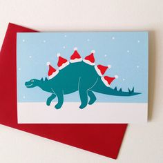 These funny dinosaur Christmas cards are guaranteed to get people smiling this festive season! Be different, send a dinosaur card this Christmas! Everyone knows that the Tyrannosaurus Rex is a fearsome predator.but he only has little arms! The sleeves o Funny Christmas Cards, Christmas Cards To Make, Christmas Hat, Christmas Humor, Christmas Crafts, Christmas Decorations, Christmas Dinosaur, Dinosaur Cards, Dinosaur Funny