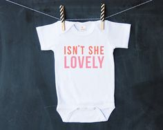 ISNT SHE LOVELY printed on a white shortsleeve baby bodysuit! Perfect for your little darling! Also comes in toddler Tshirt, pink, baby style, HENANDCO, $14