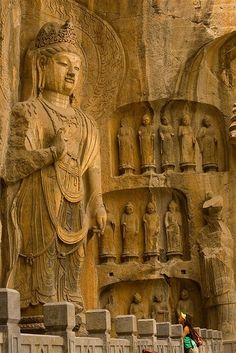 "Longmen Caves in Luoyang, Henan, China ~ one of the finest examples of Chinese Buddhist art ~ There are as many as 100,000 statues within the 1,400 caves, ranging from an 1 inch to 57 feet  in height ~ on UNESCO World Heritage List as ""an outstanding ma"