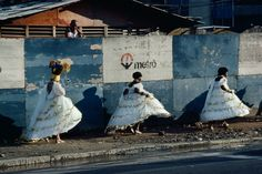 Bruno Barbey  BRAZIL. Rio de Janeiro. 1980. Samba celebrants returning home after the Carnival.