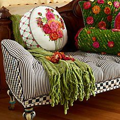 Cushions, Pillows, & Throws from Mackenzie-Childs, the black and white chaise will add whimsy to any style decor, the pillows and throws are decadent luxury.