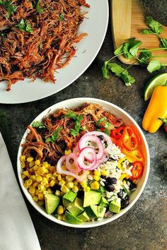 Pork Carnitas Burrito Bowls...Black bean Cilantro Lime Rice topped with flavorful slow cooker pork carnitas and your favorite toppings for a mouthwatering (and healthy) dinner! Perfect for Cinco de Mayo!