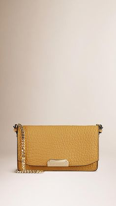 Burberry Saffron Yellow Small signature Grain Leather Clutch Bag with Chain - Structured clutch bag in signature grain leather Detachable polished metal chain shoulder strap, foldover front, hand-painted edges. Discover the women's bags collection at Burberry.com